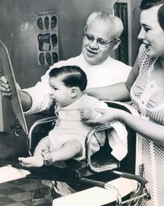 Vintage black and white, little boy first haircut.