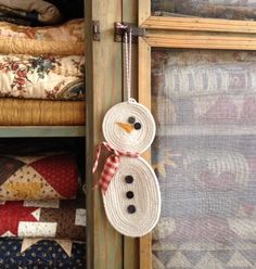 This is a full body snowman ornament! He is made from clothesline rope with gingham checked bow tie, button eyes and felt nose. Perfect for small gifts for fr