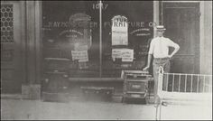 storefront, proprietor standing on the sidewalk - The Raymond-Green furniture Co., at 1017 east 12st., KCMO -  Raymond and Green were reared on Kansas farms.  They formed a business paartnership in 1910 and began operating a furniture store in KCMO the next year.  Both were good salesmen, but with the other work Green preferred handling the bookkeeping and credit, while Raymond took over the buying and advertising.