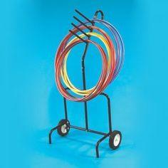 "What every home needs.  A hula hoop holder! Dimensions: Width: 32"" - Tube Diameter: 1"" - Height: 60."