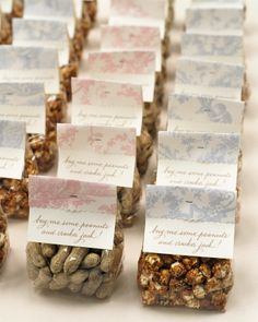 """n honor of the groom's love of baseball, this couple served peanuts and cracker jacks, in cello bags with a calligraphed tag and a lyric from the classic, """"Take Me Out to the Ball Game."""""""