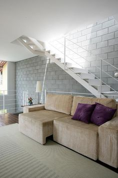A contemporary design where the humble concrete block is the hero. Vertical spaces tied togethe...