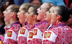 Day 16 - Team Russia sing their national anthem as they celebrate with their gold medals in the victory ceremony during the London 2012 Olympic Games. MIKE BLAKE/REUTERS