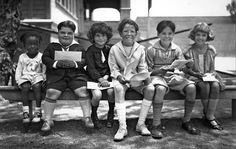 "June 1925: School is out, but for the ""Our Gang"" child actors, film production continues. Posing for an ""Our Gang"" group photo are, from left: Allen Hoskins, Joe Frank Cobb, Jackie Condon, Mickey Daniels, Johnnie Downs and Mary Kornman"