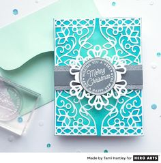 I love detailed dies, so when I saw the new Filigree Border Fancy Die (part of the December My Monthly Hero add-on collection), it was love at first sight. First, here's a look at the die itself and the cut-outs it produces. Delicate, ornamental, and so pretty! While it complements the December kit and other add-ons beautifully, I thought it would make a lovely background for a Christmas card as well. Here's what I came up with... Although the card looks detailed, the creation of it w...