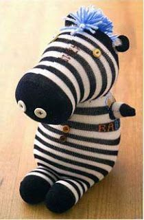 Sock Zebra tutorial.  The tutorial is not in english but every step is photographed.    I would add a braided yarn tail that matches the mane.