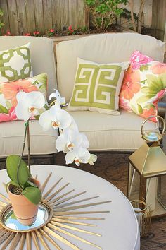 We used pillows with pops of pink, coral and green