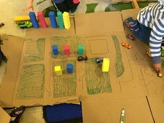 Car/city mat with cardboard boxes. Children designed it themselves. One of the many ways to use a box after a shipment.