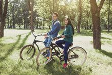 Young couple riding a retro bike