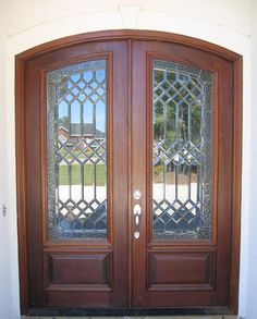 "This pair of 36"" X 96"" Style ""M-2-E"" Doors, DbyD-1014, are pictured in a Mahogany Jamb.  The Leaded Beveled Glass has a Textured Glass wrap around border.  The hardware is a Schlage handle set on the active door only in a nickel finish."