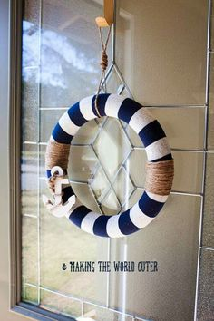 Simple, easy nautical wreath that resembles a life preserver as well! The navy and white color paired with an anchor and jute twine clearly make you see the ocean theme.