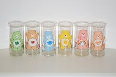 Care Bear Glasses. I remember it was Pizza Hut who were giving these away for some promotional deal. My mother got me the Grumpy Glass .