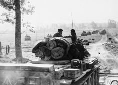 Cromwell tanks of 1st Royal Tank Regiment, 7th Armoured Division, moving up to their assembly area during Operation 'Goodwood', July 1944.
