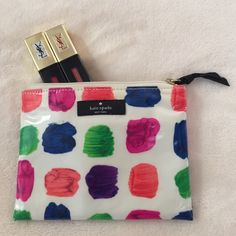 Kate Spade watercolor cosmetic pouch Kate Spade watercolor cosmetic pouch. Perfect for storing your favorite lip glosses in your bag. Never been used. Perfect condition. No stains on interior or exterior. 100% authentic purchased at Kate Spade store. Dimensions are approx. 6.5in x 5in. kate spade Bags Cosmetic Bags & Cases