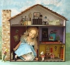 Alice in Wonderland dollhouse by Nancy Wiley. It would be cute to to a little girl photo shoot instead of a doll.
