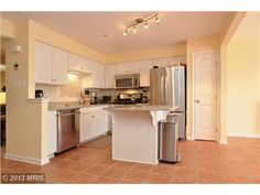 4639 Weston Place, Olney, MD 20832 — Light, Bright  spacious 3 level town house  w attached garage 3 BDRM  2 1/2 BA, 3 level townhouse with attached garage. Entry level family room w walkout  laundry closet. 2nd level has LR, DR Kitchen w stainless  granite  center island  eat-in space,appliances 1 yr. young, bonus room w deck access MA.BDRM w en suite bath  soaking tub.