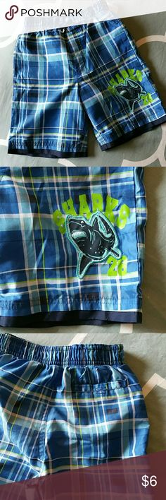 Almost New! Carter's Plaid Swim Trunks~size 4t These boys swim trunks  from Carter's look practically new!  Blue with green and white plaid trunks have elastic waistband, mesh lining, back pocket and shark detail on the left leg.  *Slight* wear on the seat and *faint* smell of chlorine. Carter's Swim Swim Trunks