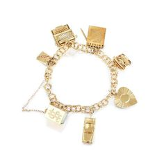 Jewelry-Auction-Featuring seven charms, crafted out of 14K yellow gold; includes safety chain; length 7 inches; weight 25.9 g. Stamped 14K, maker's mark Property of a New York Lady