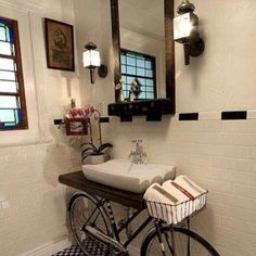 love the bicycle sink and towel basket!