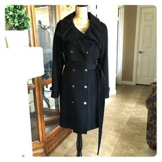 """Elie Tahari Clarissa Coat NWT Host Pick 10/21 On Sale!! Host Pick 10/21 by @chicagdl! This gorgeous coat is black in color and features a ruffled collar design and a double breasted style! The sleeves are adjustable at the ends to keep the cold out! The belt is very long so you can wear it different ways. The outside is 100% Wool. The inside is lined with 94% Polyester and 6% Elastane. Dry Clean only. The bust measures approximately 39"""" and the length measures approx 38"""". Suggested retail on…"""