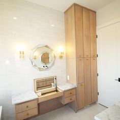 This vanity area in our 2018 Parade home had so many features! A Pull out hair dryer and curling iron drawer, makeup storage pull out, and even a concealed marble lift up vanity top with a lit mirror! Lit Mirror, Vanity Area, Curling Iron, Makeup Storage, Hair Dryer, Drawers, Marble, Cabinet, Top