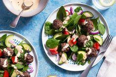 Greek meatballs with tomato-cucumber salad and lemon-tahini dressing