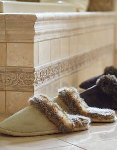 After a long day in street shoes, slipping your feet into our faux fur-lined slippers will feel positively decadent.
