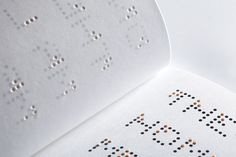 Storybook For All Eyes set with a custom-designed font that incorporates both braille and english letters into a single typeface
