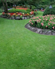 Im going to do some serious Landscaping renovations this summer and I love these flower gardens