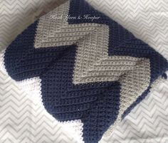 Crochet Baby Blanket Chevron Baby Blanket by HookYarnAndHooper $89.99 Crocheted baby boy blanket in navy blue and gray with a single white stripe. This stylish baby blanket is preppy and sporty and makes a great gift for a nautical theme or Cowboys fan. This blanket measures 30 by 38 inches and was handmade in a smoke-free home.  #craftshout0415