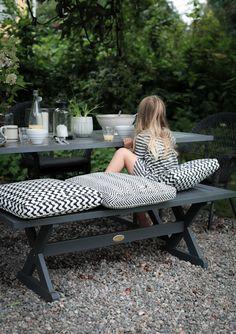 DIY version: paint picnic table & benches black; add black/white geometric cushions
