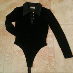 Black velvet body suit unitard Bcbg max azria black velvet body suit/unitard. My aunt gave this to me from her closet, but I've never worn it, didn't know how to style it! Authentically vintage, I believe this is from the 80s or 90s. Has a satin collar and crystal diamond like buttons. Bottom crotch has snap buttons.  In excellent condition and no signs of wear!  Tag says this is real velvet, also comes with extra crystal diamond button. Dry clean only. (see third and fourth pic)  Comes from…