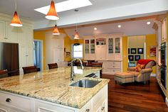 Kitchen with white cabinets, kitchen islands and eat-in area