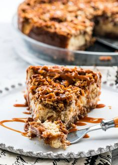 This Pecan Pie Cheesecake takes two of my favorite desserts and combines them into the only thing that's better than a classic pecan pie. This incredible pecan pie cheesecake is everything a cheesecake should be, decadent, luscious and simply delicious! Pecan Pie Cheesecake, Cheesecake Recipes, Pecan Recipes, Sweet Recipes, Pecan Desserts, Holiday Baking, Christmas Baking, Fun Baking Recipes, Cooking Recipes