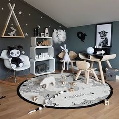 How lovely is this play corner by 👈🏻 The World rug, Joseph Bunny Lamp and Design Letters water bottle are all available online 💫 .