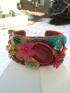 Bead embroidered cuff bracelet using lucite flowers and  cabochons by Karen Lee