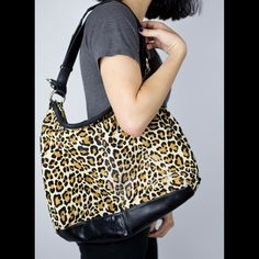 Cole Haan Cheetah Print Genuine Cow Hide Purse This purse is a staple. It is spacious and sturdy. It does have slight wear on it pictured. It is not noticeable unless one really looked. Make me an offer! The purse material is genuine cow hide! Cole Haan Bags Shoulder Bags