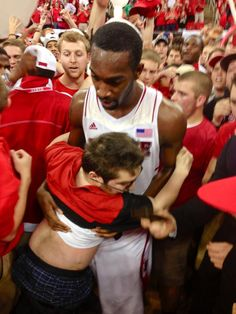 """Meet C.J. Leslie. He's a NC State basketball player, after leading his team to victory fans stormed the court to celebrate. Will Privette, a die-hard fan was shoved out of his wheelchair by fans and was nearly trampled to death until C.J. came along. Privette said he would have died if it wasn't for C.J. who protected him and helped him find his wheelchair again, """"He held me for a couple of minutes. I was screaming & yelling"""" If you think C.J. is awesome and deserves some respect LIKE this."""