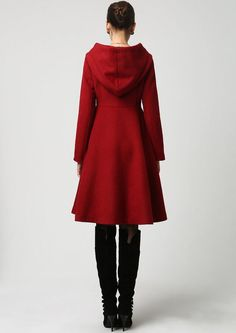 Truly a classic, this midi length wool coat features a beautifully structured, triangular shaped, empire waist bodice with seam detailing that leads in a wide flowing skirt. Dark red coats never go out of style so you will get years of wear. This design also features a warm hood, extra long sleeves, three fabric-covered button closure and polyester lining.~ *Thanks to G.B. Oliver for helping me write the description.  Womens Clothing Coat. Red Wool Blend with Polyester Lining & Seam Detail…