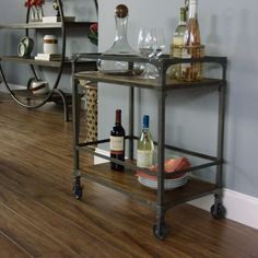 Bring an industrial-chic feel to your kitchen or home bar with this stylish bar cart, made of rustic metal and mango wood. This portable, four-wheel cart is perfect for parties, moving easily from one room to another.