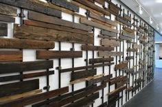 Whitmarsh built this sculpture out of salvaged construction wood and steel pipes. The piece is 9 feet high, but is 50 feet wide, stretching out along an entire length of the building.