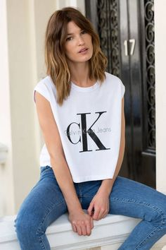 Calvin Klein & MyTheresa.com have collaborated to reboot a '90's favorite: the logo tee. See all the chic campaign photos.