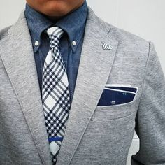 Stone gray blazer, plaid navy + white mens necktie, denim blue shirt, and pocket square