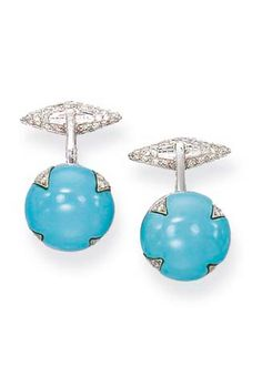 A PAIR OF TURQUOISE AND DIAMOND CUFFLINKS  Each circular turquoise terminal with inset diamond detail to a hinged diamond baton, mounted in 18k white gold, with orange silk case Stamped MdV for Michele della Valle