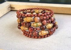 Paper bead and crazy lace Agates beaded memory wire by stillrain