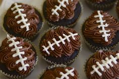 Football Cupcakes made Easy! Using a small star tip in a pastry bag, zig-zag chocolate frosting in a diamond shape on the cooled cupcakes. The vanilla frosting into a bag with a small round tip and pipe on the laces. Enjoy!