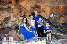 Beautiful family Photo. Styled in blue on the beach.  Photograph taken by Rikki-Lee Wrightson of Pregnant Memories Photography