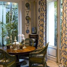 Incredibly pretty breakfast corner ...lovely wall treatment ... Gorgeous curtains ...The table ...Tiny but charming .