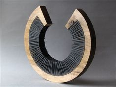Benoît Averly turns and carves wood. As he creates his sculptures, he looks carefully at lines and shapes. He likes sharp contrasts, the play of shadows, black and white. Inspired by architecture...