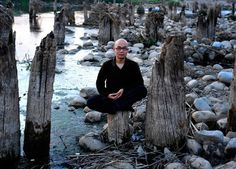 A Chinese hermit meditating on a tree stump in Mt. Zhongnan, Xi'an, Shanxi province